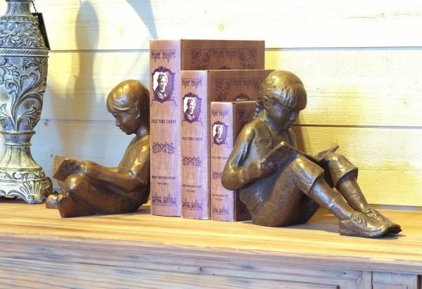 Geschwisterpaar als Buchstützen Bronzefiguren